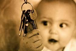 baby holding keys