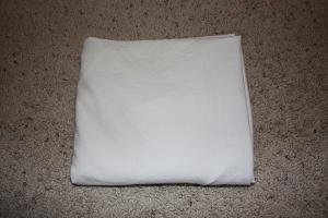 neatly folded fitted sheet