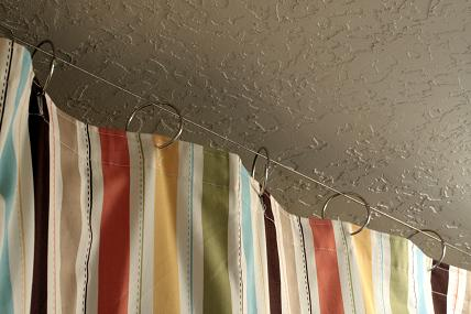 for very inexpensive shower curtain hanging use 2 book rings